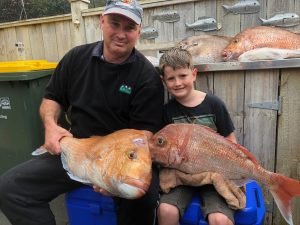 Nick Young with son holding two large snappers